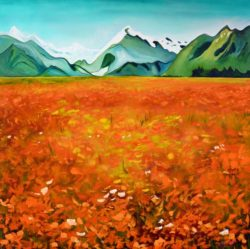 Teal, snow-capped mountains in the background of a field of dappled flowers and grass