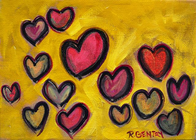 Several multi-colored, abstract hearts of varying seizes arrayed on a textured yellow-green background