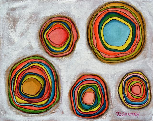 Five floating sets of brightly colored concentric circles seeming to undulate on white background