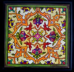 A painting that looks a bit of a Mexican tile using an intricate design featuring a stylized flower motif, in a black matte frame.