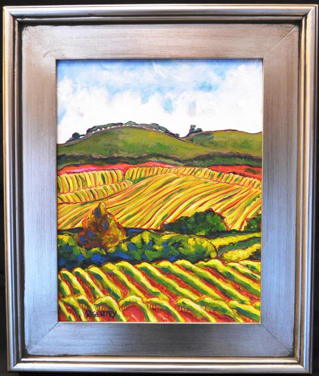 Rolling vineyards of California wine country on a beautiful sunny day in a silver wooden frame